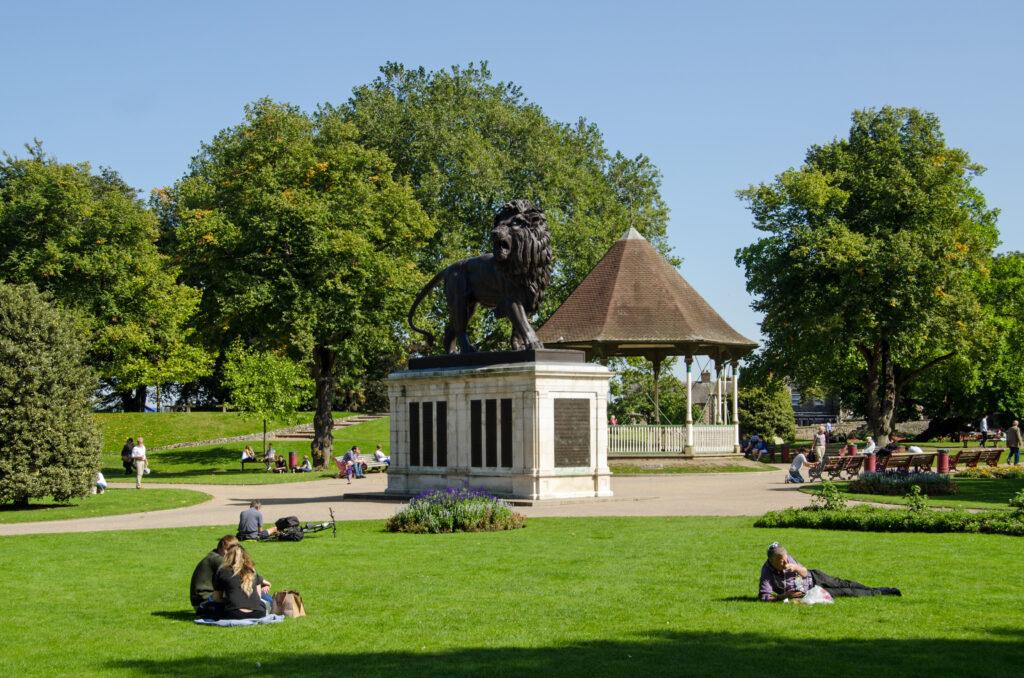 People enjoying the sunshine in Forbury Gardens in Reading, Berkshire